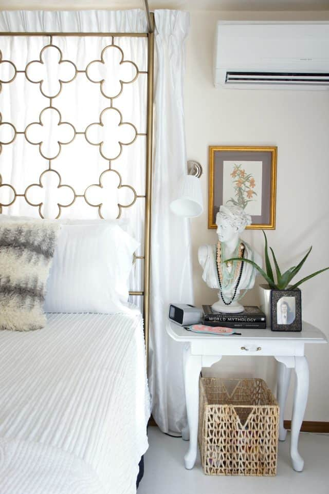 add interest to a rental bedroom with art, plants, and texture