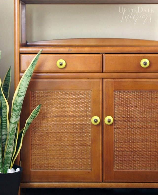 Updated rattan furniture with knobs and snake plant for eclectic global style