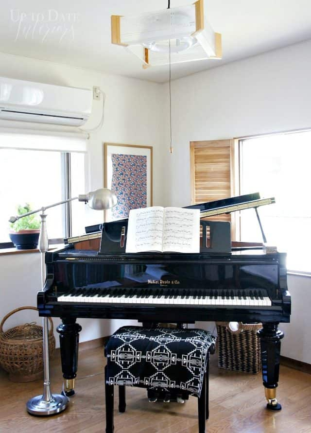 grand piano furniture arrangement in small living room