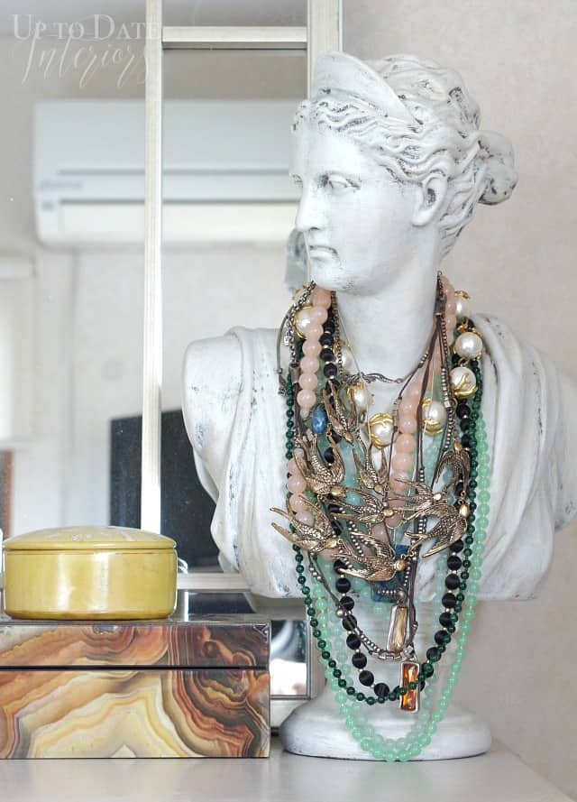 woman bust to hold necklaces in a global eclectic bedroom
